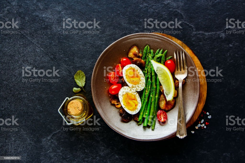 Aspargus and egg on plate stock photo
