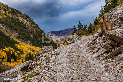 Aspen area rough narrow mountain road to old mill.