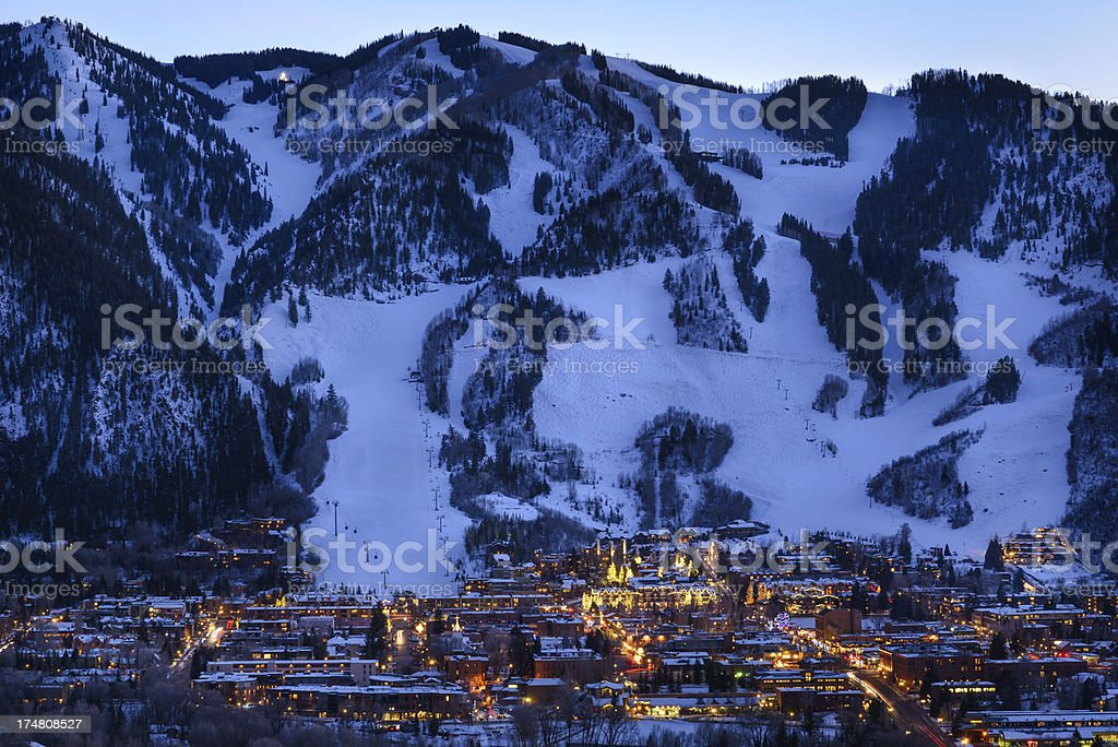 Aspen Colorado Town and Ski Slopes at Dusk stock photo