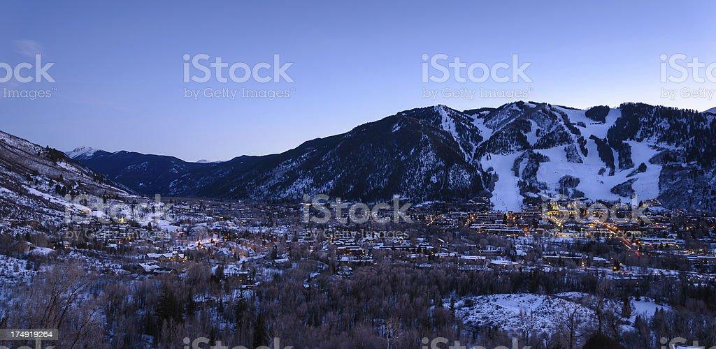 Aspen Colorado Town and Ski Slopes at Dusk stock photo