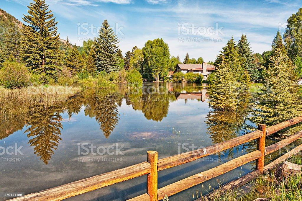 Aspen Home and Pond with reflections stock photo