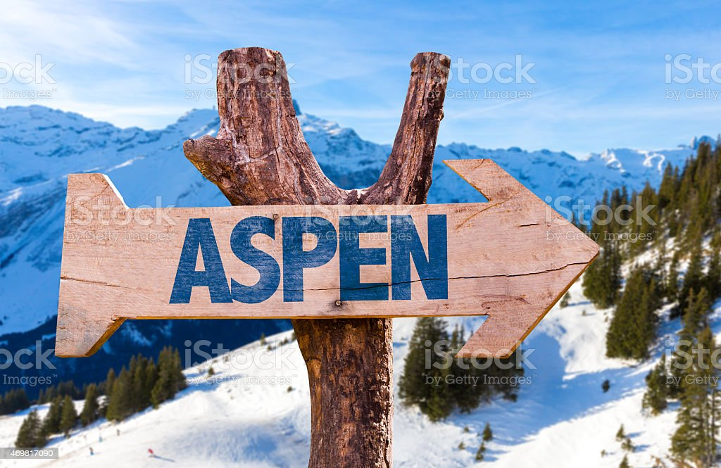 Aspen wooden sign with alps background stock photo