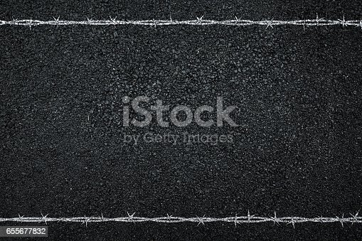 91708255 istock photo Asphalt and barbed wire. 655677832
