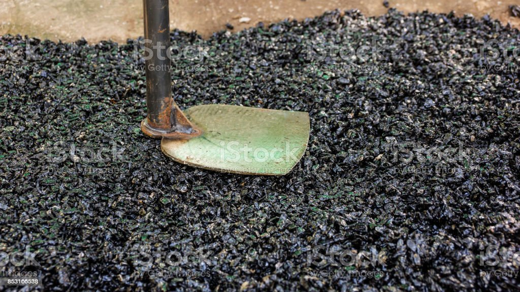 asphalt and hoe for repairing a road. stock photo
