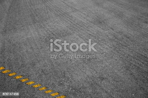 485413653istockphoto Asphalt background texture with some fine grain with road 826147456