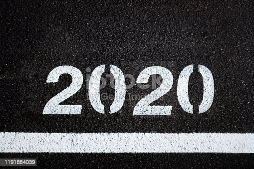 istock Asphalt background with 2020 new year lettering. 1191884039