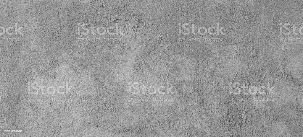 Asphalt close-up, wet concrete wall texture. stock photo