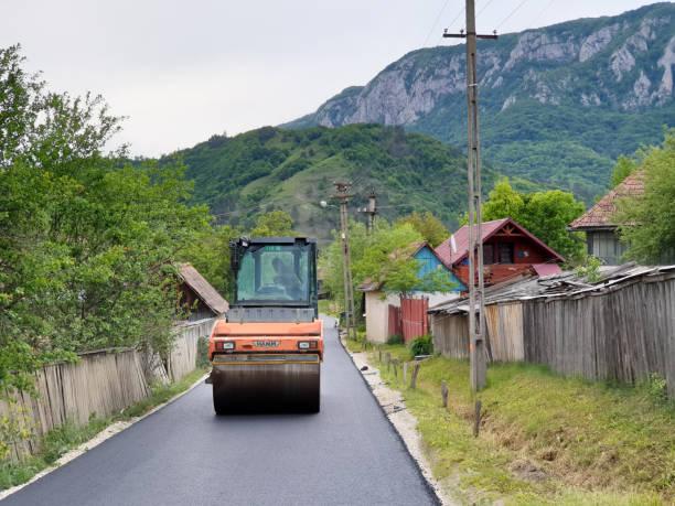 Asphalt compactor roller in Salciua village stock photo