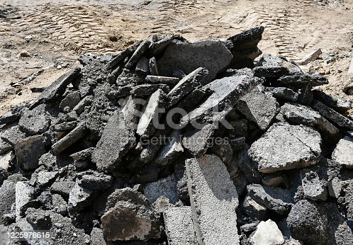 Asphalt construction material after braking the road