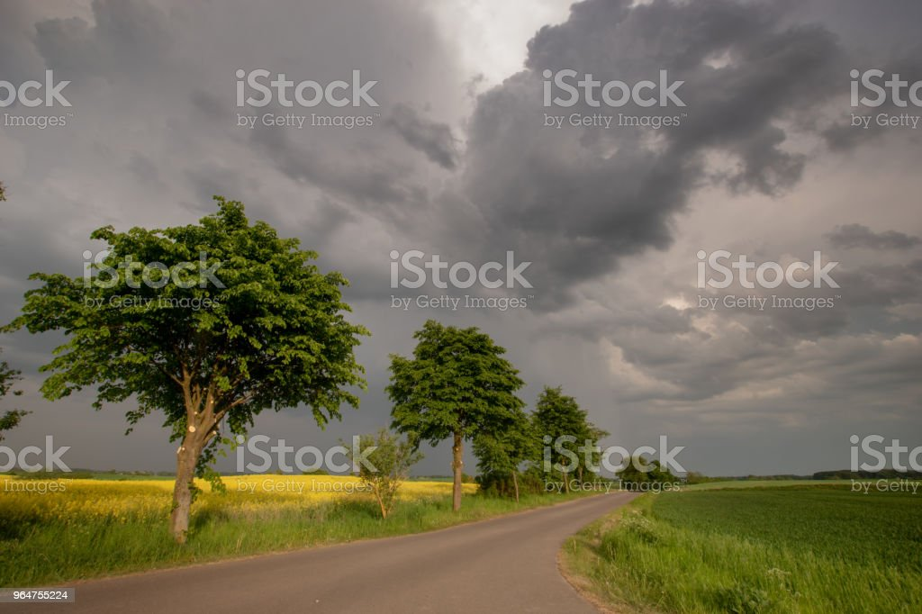 Asphalt country road and spring storm royalty-free stock photo