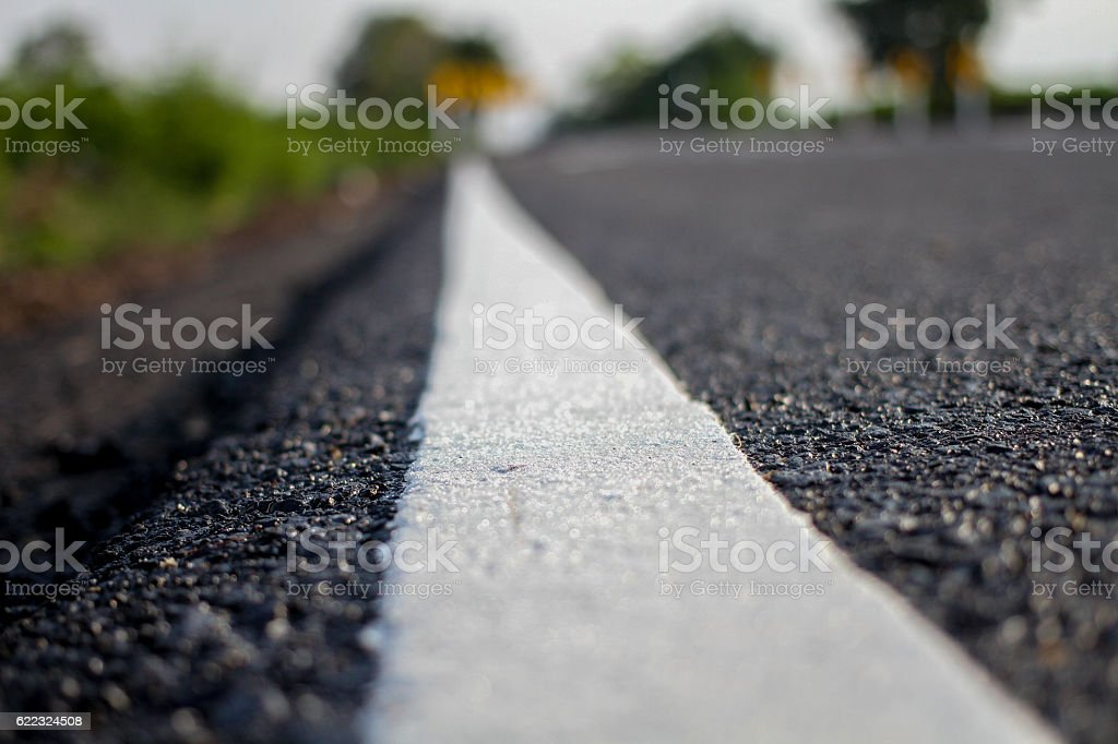 asphalt country road and white line stock photo