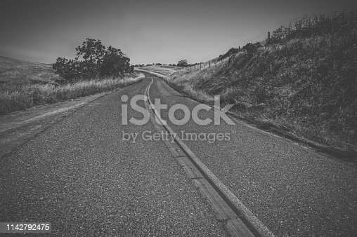 Asphalt country road in Western of USA, black and white
