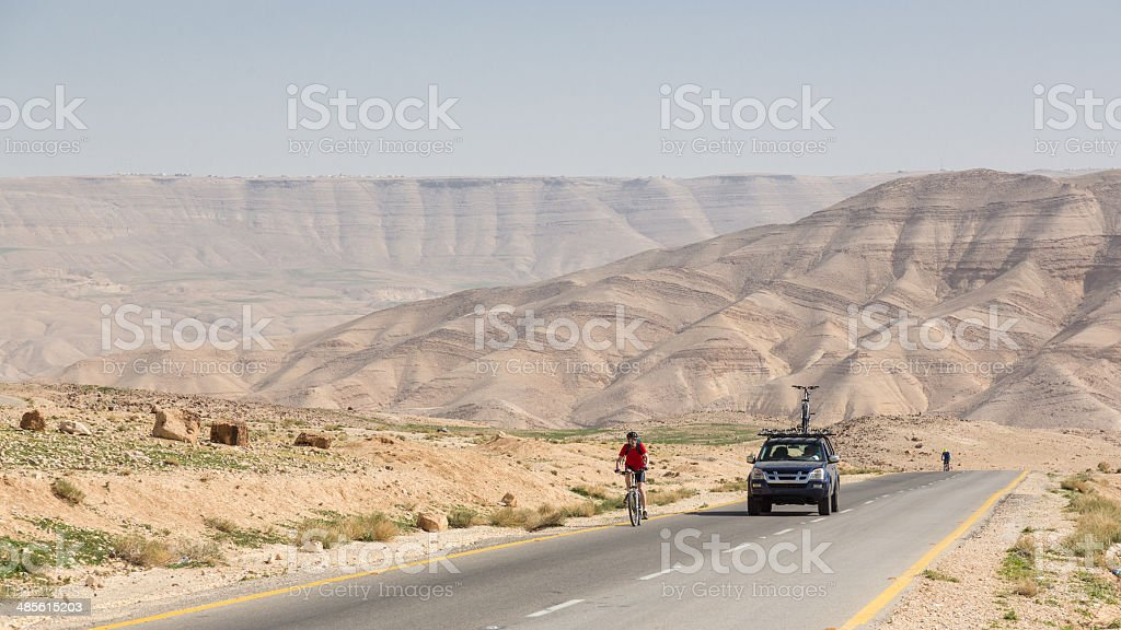 Asphalt cycling in the Jordan desert royalty-free stock photo