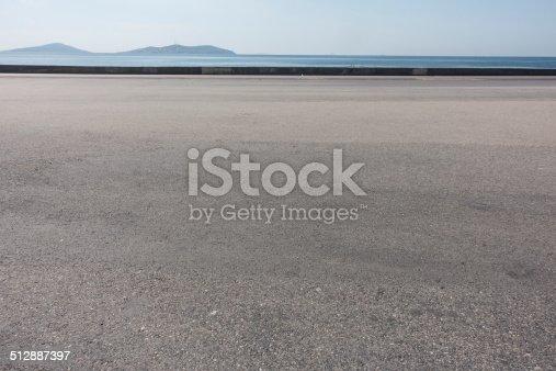 asphalt ground space with seaside background