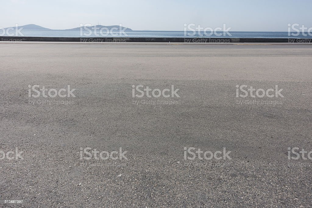asphalt ground space with seaside background stock photo