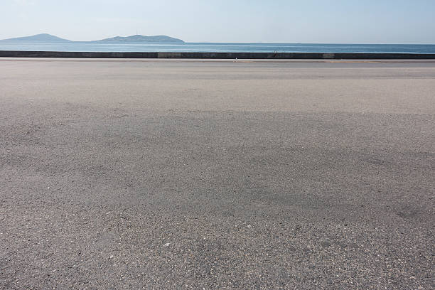 asphalt ground space with seaside background asphalt ground space with seaside background asphalt stock pictures, royalty-free photos & images