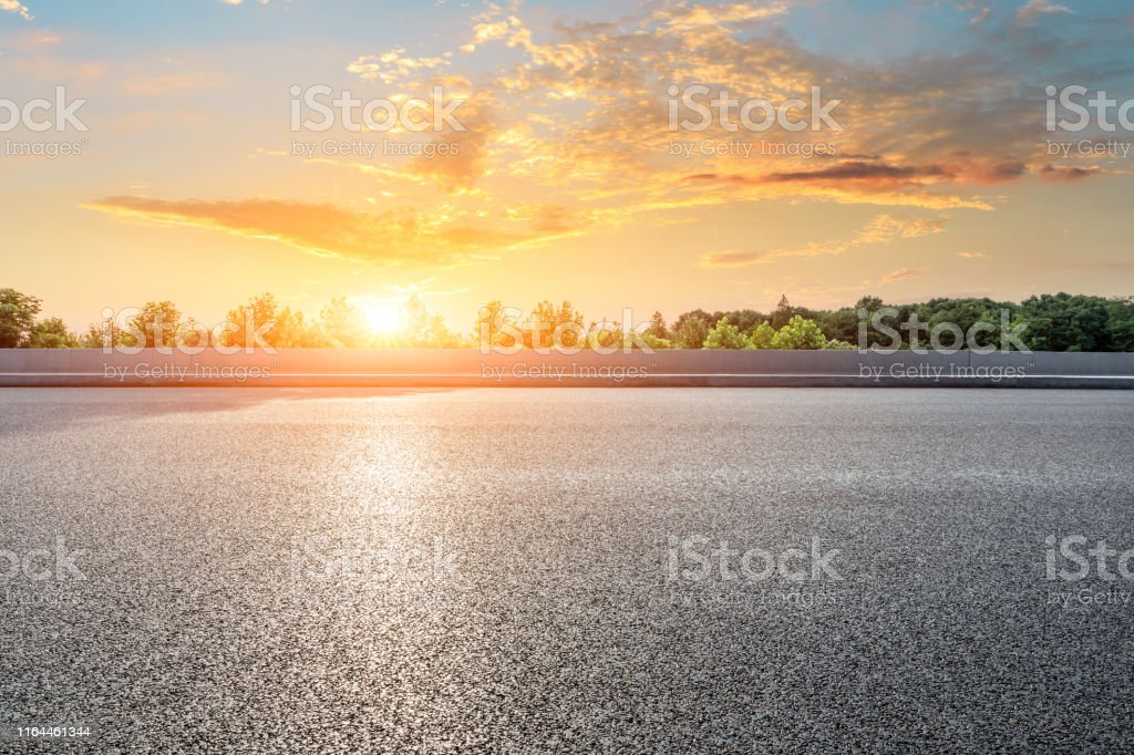 Empty asphalt highway and green forest with beautiful cloud landscape...