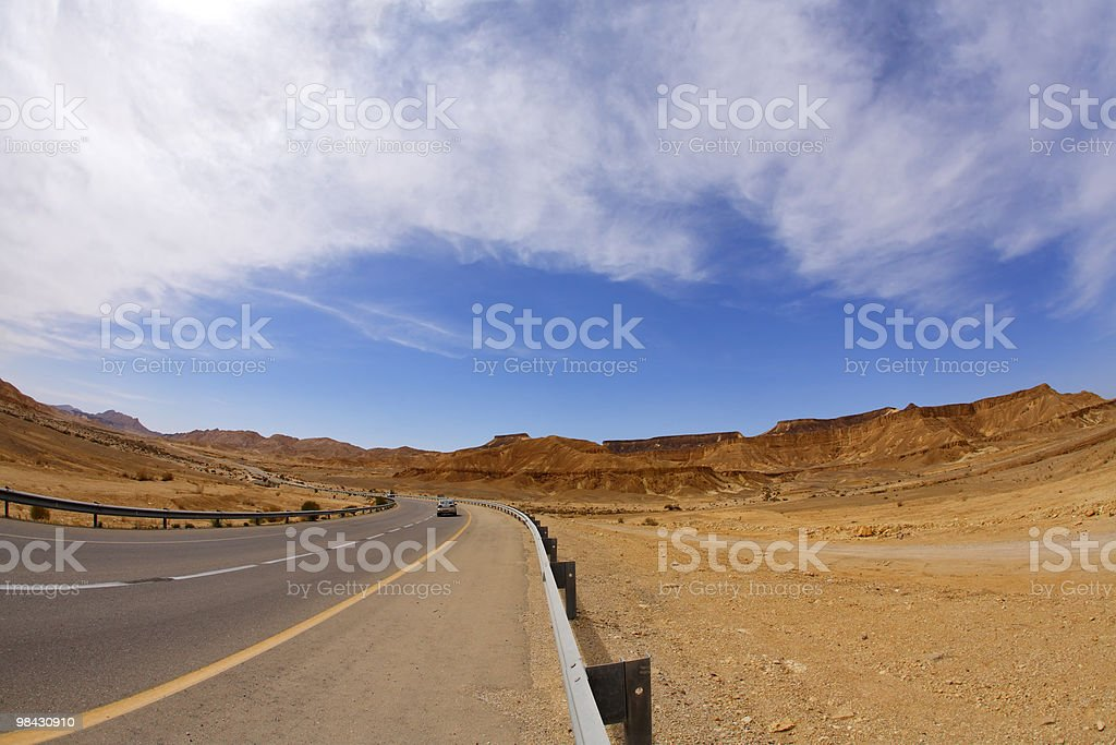 Asphalt highway in stone desert royalty-free stock photo