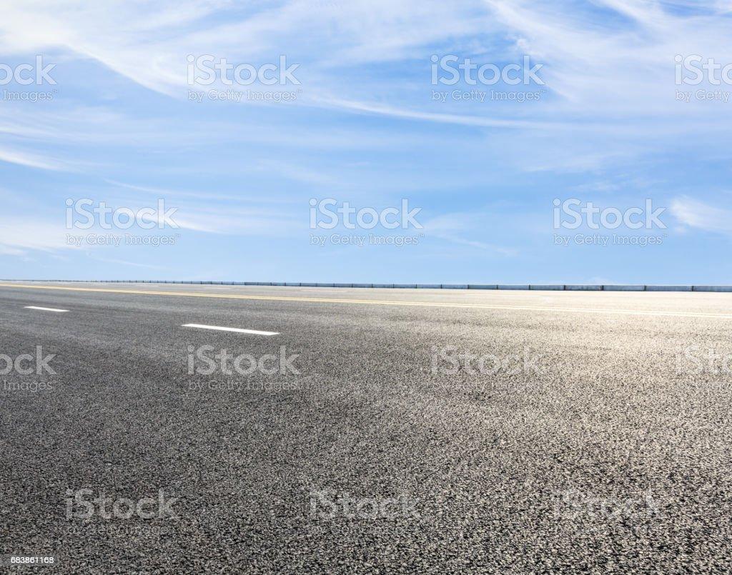 asphalt highway road under the blue sky stock photo