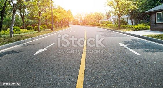 Asphalt highway with arrow sign.