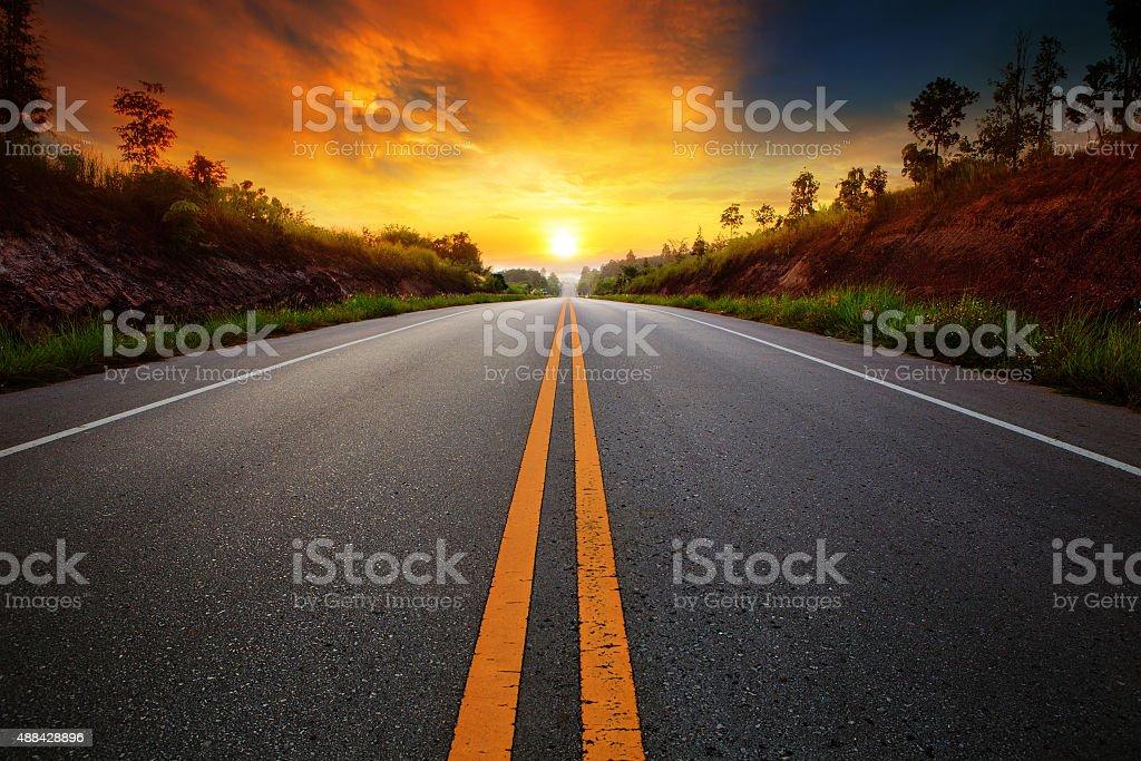 asphalt highways and sun set scene stock photo