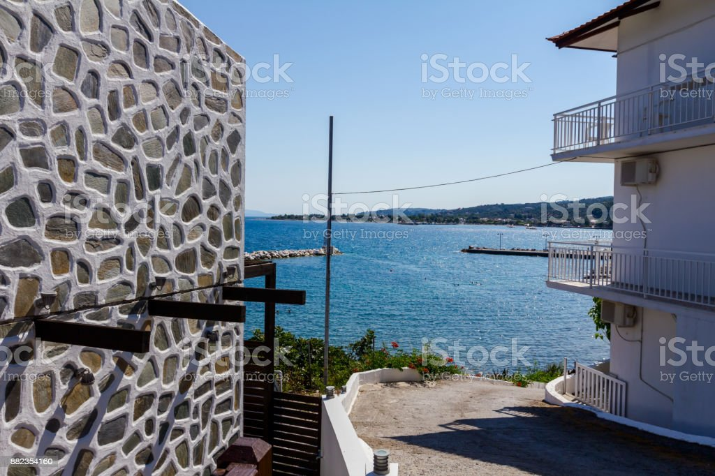 Asphalt is going trough decorated settlement, downhill street stock photo
