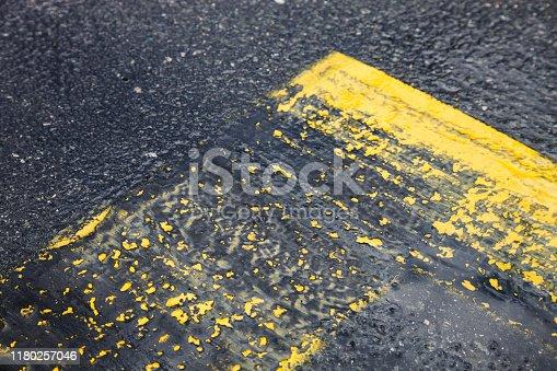 621693226istockphoto asphalt marks 1180257046