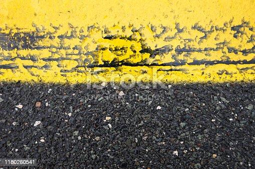 621693226istockphoto asphalt marks 1180260541