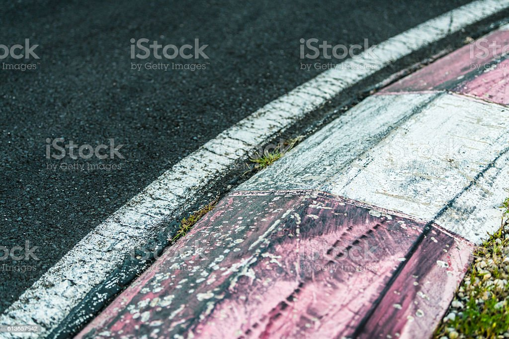 Curve of asphalt motorsport racetrack. Taken by Sony a7R II, 42 Mpix.