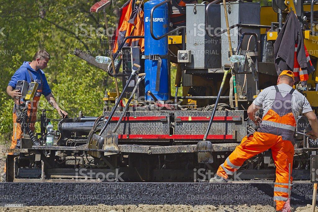 Asphalt paving machine stock photo