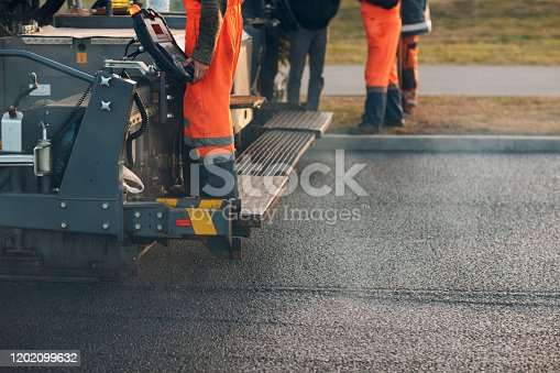 Asphalt paving. Paver machine and road roller. New road construction.