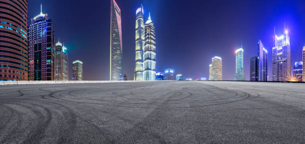 Cтоковое фото Asphalt race track and modern skyline and buildings in Shanghai at night