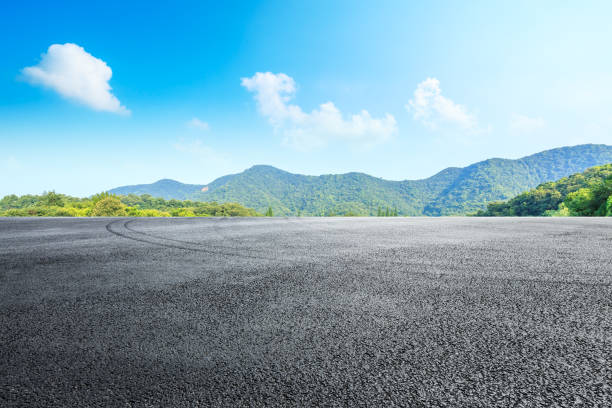 Cтоковое фото Asphalt race track and mountains with blue sky landscape