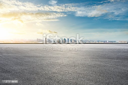 istock Asphalt race track ground and modern city skyline with buildings in Shanghai 1137518695