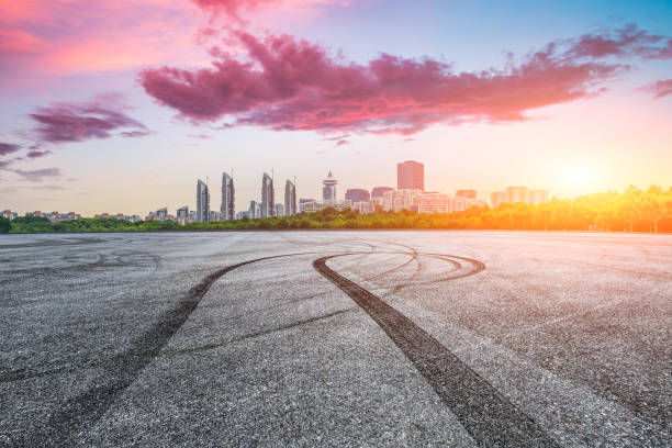 Asphalt race track road and city skyline with buildings in Shanghai at sunset. stock photo