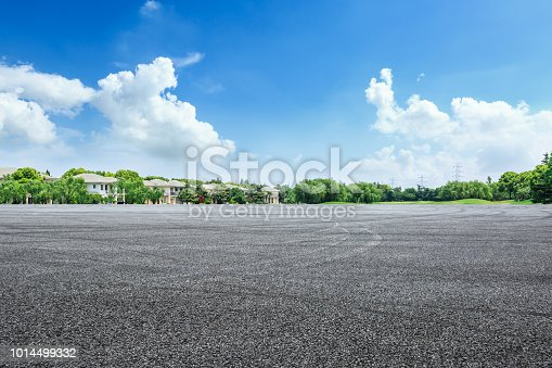 istock Asphalt road and apartment buildings in urban suburbs 1014499332