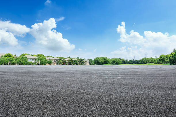 Asphalt road and apartment buildings in urban suburbs stock photo