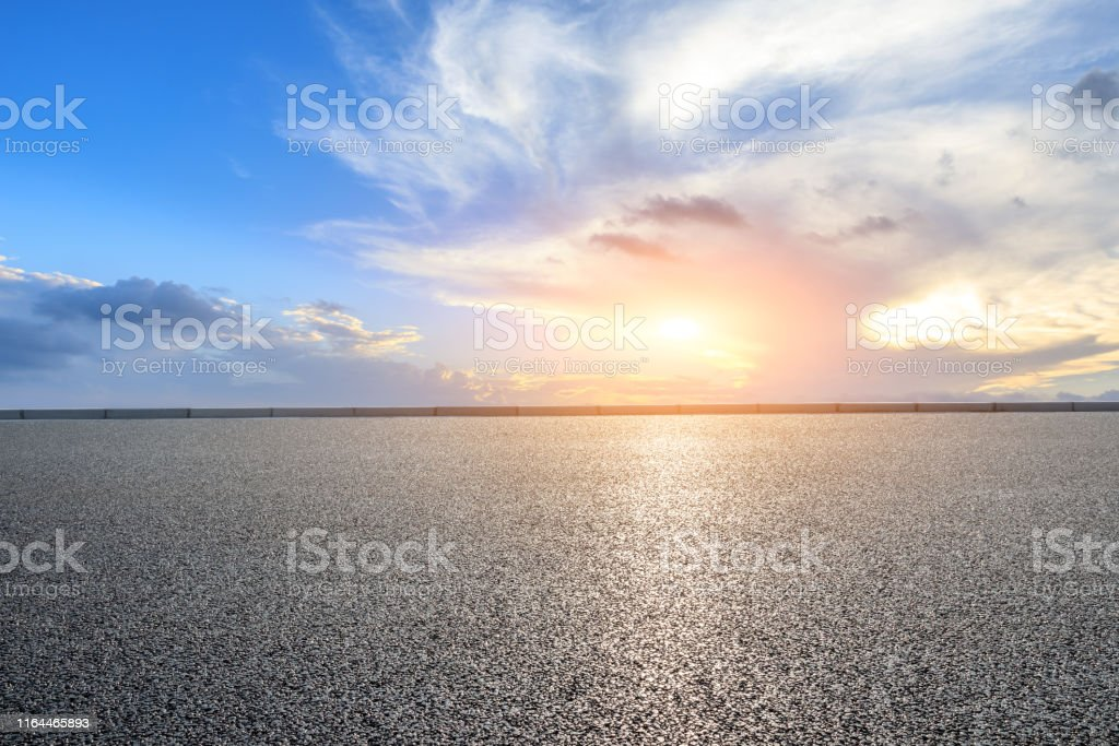 Empty asphalt road and beautiful clouds landscape at sunset