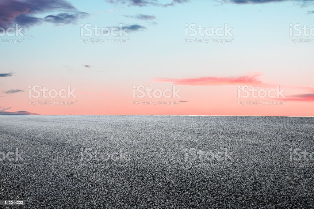Asphalt road and beautiful sky landscape at sunset stock photo