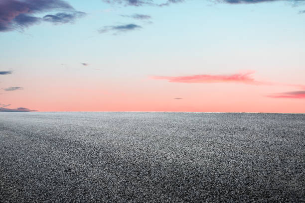 Asphalt road and beautiful sky landscape at sunset stock photo