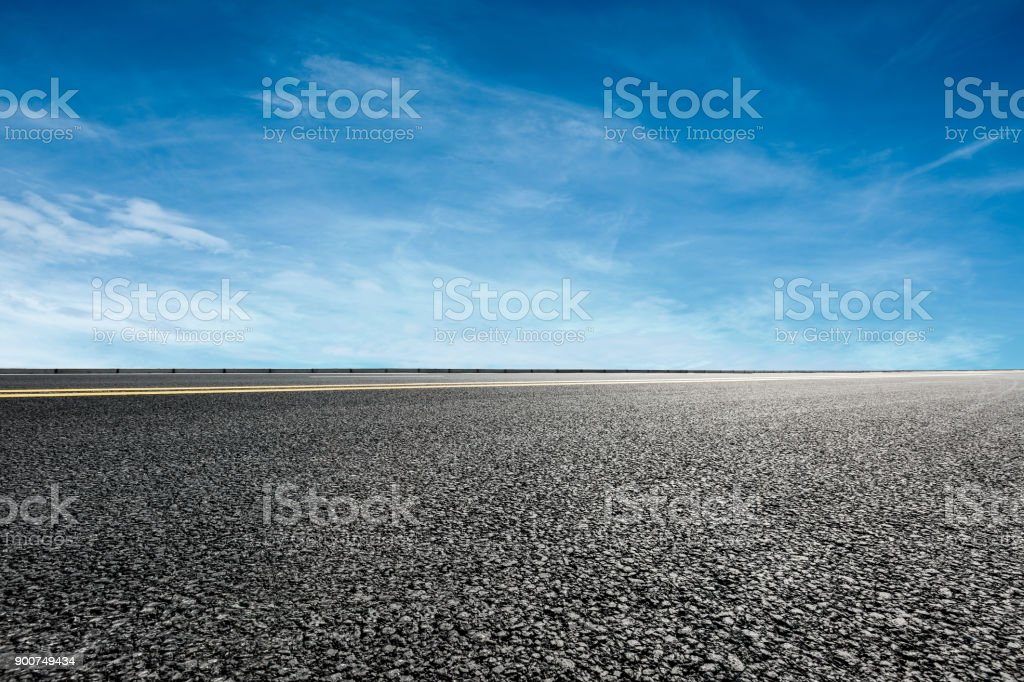 asphalt road and blue sky and white clouds scene stock photo
