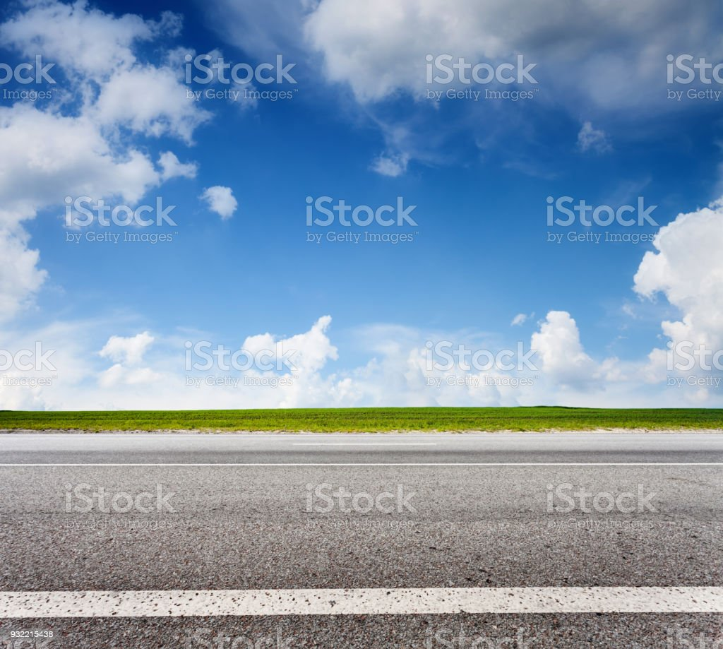 Asphalt road and blue sky, side view stock photo
