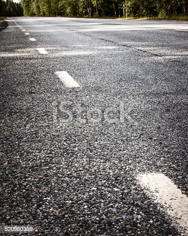833130962 istock photo Asphalt road and dividing lines 520960359