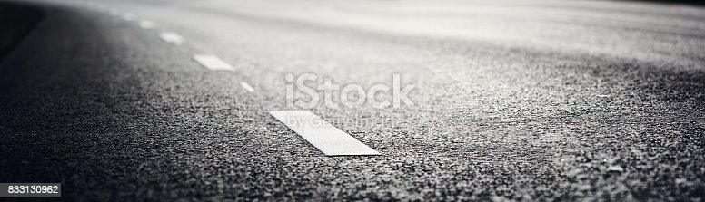istock Asphalt road and dividing lines 833130962