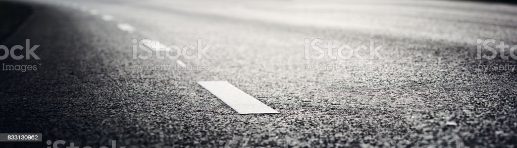 Asphalt road and dividing lines stock photo