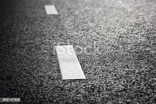 833130962 istock photo Asphalt road and dividing lines 833142308