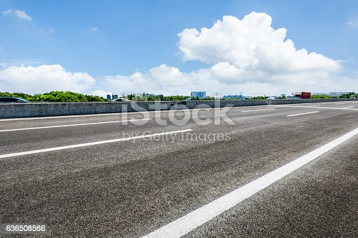 621693226istockphoto Asphalt road and forest 636508586