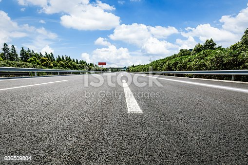 621693226istockphoto Asphalt road and forest 636509804
