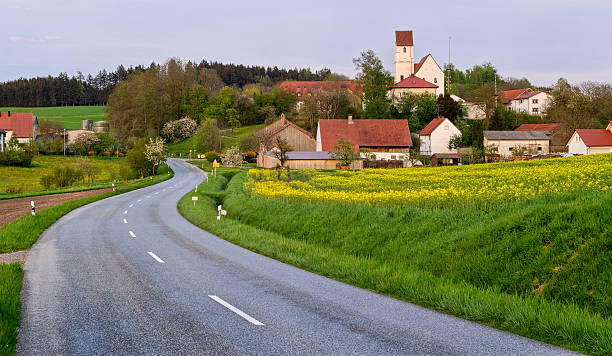 asphalt road and german village - village stock pictures, royalty-free photos & images