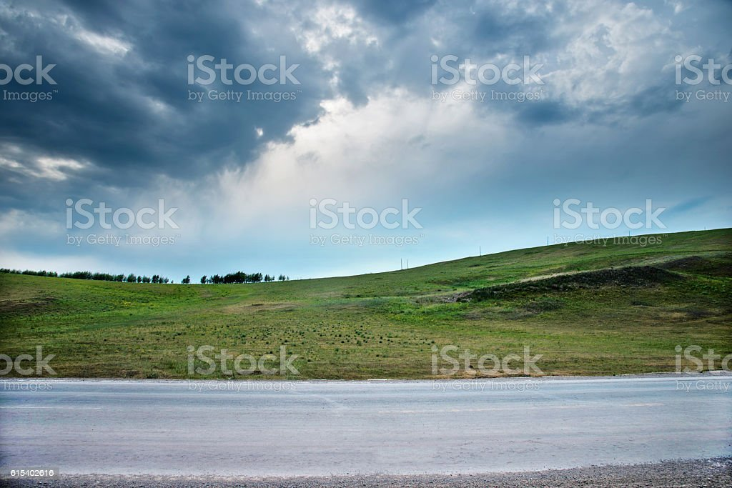 Asphalt road and green field stock photo